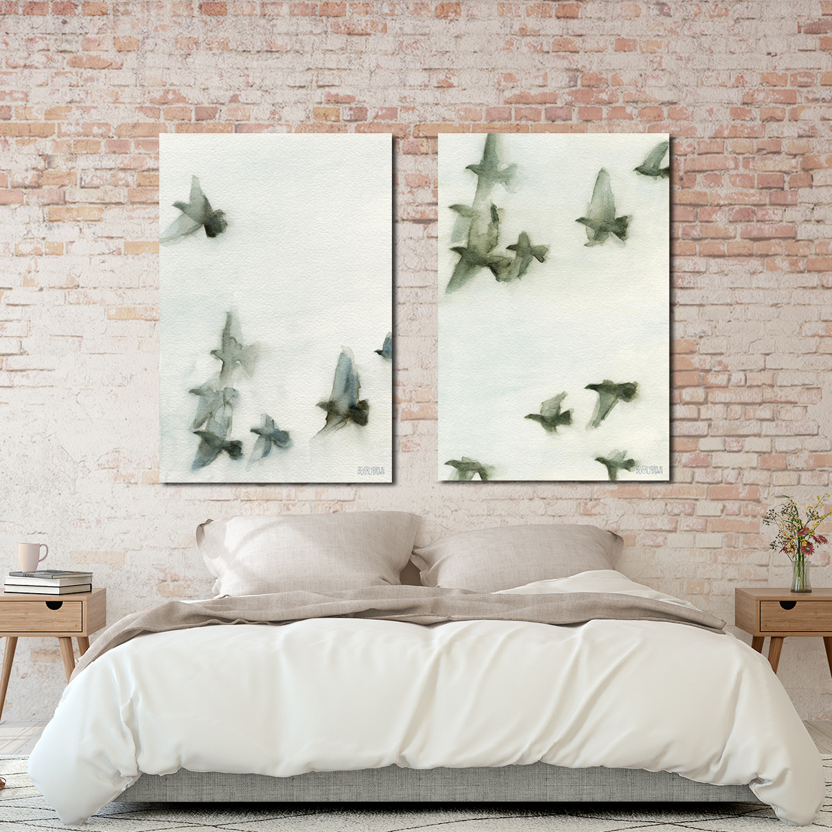 Set of two grey and blue canvas birds in flight wall art prints over the bed. www.beverlybrown.com